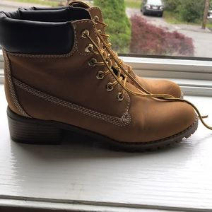 Brown woman's report work boots with a slight heel